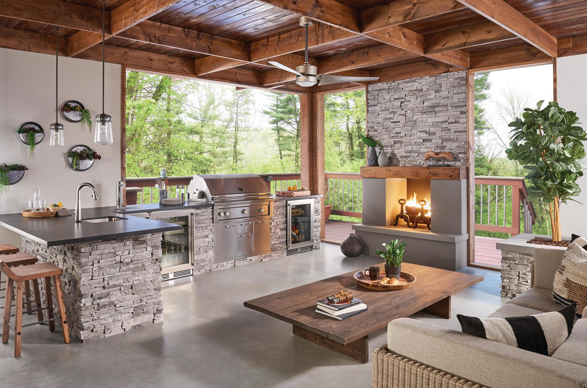 Outdoor Kitchen and Fireplace by Kindred